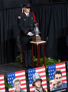 A bell is rung for each fallen firefighter during a memorial service at Tim's Toyota Center in Prescott Valley, Ariz., on July 9.