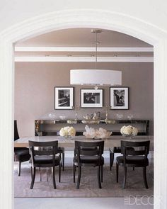 Dining room - statement light, simple feature sideboard, black and white photos