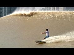 "Surfing China's River Wave - The ""Silver Dragon"" A super fun wave where you least expect it!"
