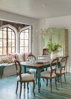 The owners of this Arkansas home saved only the pieces of original furniture with potential or items that were stunning as is, like the sage cupboard and the chippy dining table.
