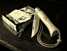 Opinel #6 with filework and wrist lanyard...