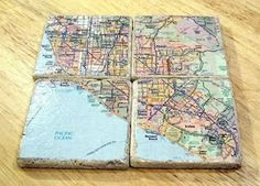 These coasters are made with cheap ceramic tiles from any home improvement stores.  Decoupage any napkin, paper, map, etc, and have personalized coasters!