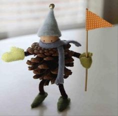 Pine cones and pipe cleaners. and for the scarf maybe even an old sweater. flag toothpics and paper.