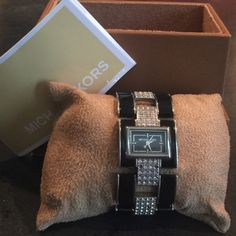 MK Michael Kors Watch Beautiful MK watch- black and silver with crystal links!One of my favorites! Perfect with any outfit! Casual/ Work/ Night. (Missing a total of 5 crystals) normal wear signs Michael Kors Accessories Watches