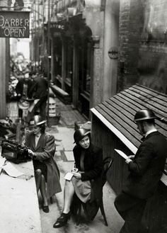 Clerks from a London office in Brodie helmets, after being forced outdoors by bomb damage to their building, 1940 ~ (Photo by Rolls Press/Popperfoto/Getty Images) ~ Uk History, London History, British History, Women In History, Vintage London, Old London, The Blitz, London Pictures, War Photography