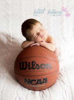 Basketball Photo. Newborn Photography Pose. Smiling Newborn. Sports Baby. Wilson. NCAA. Taken by Infant Imagery. Infant Imagery serves Western Colorado including the Montrose, Delta, Telluride, and Grand Junction areas. www.infantimagery.com