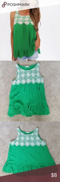 🌿Green and white crochet top🌿 This top is green with white crocheted flowers. It ruffles at the bottom. The green top loose fitting and very comfortable. It was only worn once. The top is 100% rayon. It has thinner straps which is perfect for summer time. It goes perfect with a pair of cut-off shorts or skinny jeans. The top is in great condition, no stains and no loose threads. Tops Tank Tops