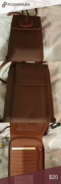 Outland wallet purse. New. Two zipper Pockets, several pockets for cards and license, a pocket for cell phone or glasses and a pocket for checkbook outland Bags Mini Bags