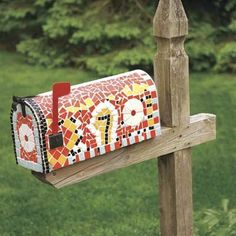 Dress up your mailbox with leftovers from other projects. Try using molding scraps to trim out the wood post, and brightly colored tiles left over from a kitchen backsplash or bathroom shower enclosure to create a crafty mosaic on the box itself...  cool!  Finally an idea to dress up the wall mailbox on the house.