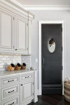 Black upholstered swinging pantry door