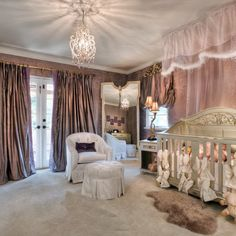 In this grand nursery, a filigreed crib takes center stage below a sheer canopy. Mauve damask wallpaper and lavish window treatments up the style in this bedroom fit for a princess.