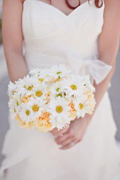 Daisy: http://www.stylemepretty.com/2016/01/28/symbolic-wedding-flower-meaning/