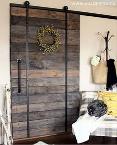 UPCYCLED BARN DOOR no title1 563x700 DIY Barn Door and DIY Barn Door Track That Wont Break the Bank!