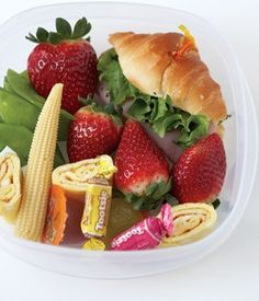 Love this bento box combo idea although I prefer to keep the individual foods separate. Features of this idea include a ham sandwich on a mini croissant, strawberries, omelete rolls, baby corn, snap peas, small fruit-flavored jellies, and candies. For more creative ideas for kids lunches LIKE US on Facebook @ https://www.facebook.com/SchoolLunchIdeas