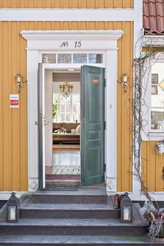 Love the door trim, and the white beltlines splitting the siding Swedish Style, Swedish House, Exterior Trim, Exterior Doors, Scandinavian Furniture, Scandinavian Interior, House Trim, A Frame House, Country Style Homes
