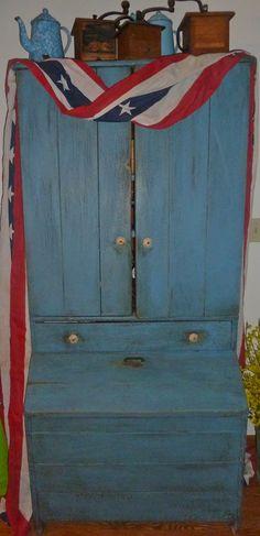 Prim Blue Cupboard...with old vintage coffee grinders.