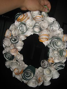 Kelly's Paper Rosette wreath with scrapbook paper and book pages.  Not a tutorial.