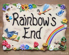 This beautifully hand made whimsical ceramic house sign is personalised with your house name and, or number. Designed with rainbows, leprechaun, birds and toadstools.