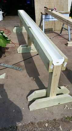 Gutter garden on raised stand - great idea for patio or balcony. Accessible for wheelchair.