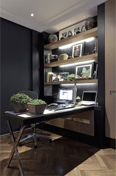 dark wall, wood chevron floors, handsome desk, makes a stunning room