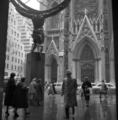 NYC. Frank Oscar Larson. // This shot, taken on a rainy day across from St. Patrick's Cathedral, is one of thousands of snaps found in an attic in 2009. After his two sons left home, Frank Larson found more time to fulfill his passion for picture-taking. The thousands of negatives discovered, according to the Queens Museum of Art, were organized into more than 100 envelopes onto which Larson had carefully noted the locations, dates and times they were taken.