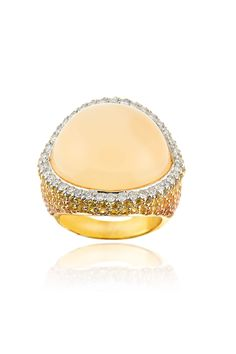 Borrow this stunner for daytime drama at your fingertips or sexy night time sparkle. Haute Vault's 18K yellow gold and champagne moonstone cocktail ring features a gorgeous row of diamonds that accent the subtleness of the moonstone. Orange and yellow sapphires dance into deeper color down the shank of the ring creating drama at every angle. Ring Size 7; Available for rental at www.hautevault.com
