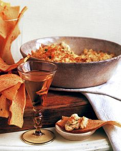 "A longtime party favorite, this dip contains a number of assertive seasonings that balance the richness of the cheeses and the crab. The recipe comes from ""Martha Stewart's Hors d'Oeuvres Handbook."""