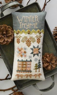 Winter Tyme is the title of this cross stitch pattern from Hands On Design and the price includes the design, three vintage mini bells as well as the Lady Dot Creates rickrack.