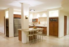 #Kitchen Idea of the Day: An open plan kitchen with an island integrated into a structural post.
