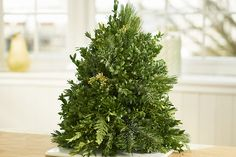 Learn how to make a DIY Christmas tree that's perfect for your table, desk or small area. Add some extra flair with our Christmas tree decoration ideas! Christmas Advent Wreath, Tabletop Christmas Tree, Mini Christmas Tree, Christmas Ideas, Christmas Crafts, Homemade Christmas, Rustic Christmas, Thanksgiving Decorations, Christmas Tree Decorations