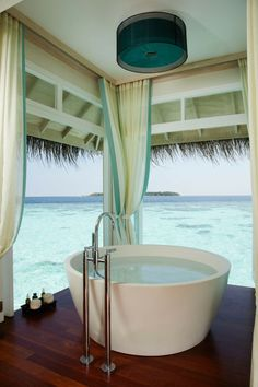 Uh hi yeah, if my house was this close to the beach, especially my tub, i'd never be able to stay out of the ocean. the tub would be pointless.