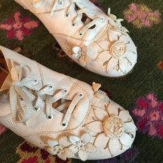 Anna Sui white leather floral embellished sneakers Super rare, sporty yet feminine sneaker by Anna Sui. Bought at Anthropologie. White leather with 3-D leather embellished flowers. Lace up with gum sole. Made in Italy. In near perfect condition, worn only a few times as they were always too snug for me :( there look amazing with a spring dress. Anthropologie Shoes Sneakers