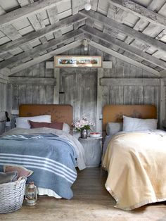 Bright idea: Turned upside down, an old metal washtub works as a nightstand. #bedroom #decor