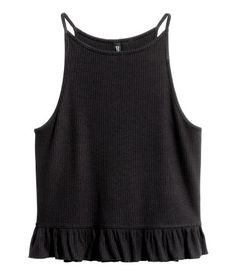 Black. Short tank top in ribbed viscose jersey with narrow shoulder straps and flounce at hem.