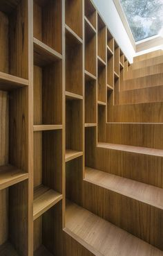 closeup of cool stair bookshelf ... Pinewood of Marina House | Architects: Massimo Fiorido Associati + sundaymorning | Location: Marina di Castagneto Carducci, Tuscany, Italy | Photographs: Fabio Candido