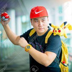 Trainer boy playing pokemon , pokemon ball and Pokemon Go gameplay screenshot on the phone