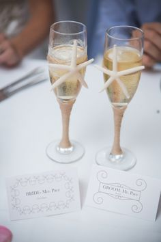 DIY Beach Wedding // embellished champagne glasses for a rustic, beach wedding // image: Tony Gambino Photography