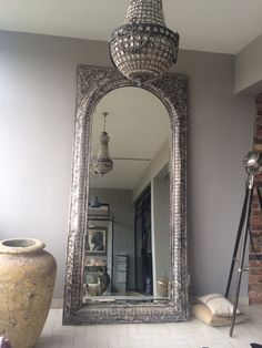 full length mirror makes a statement  with another Italian pot .. Love pots !