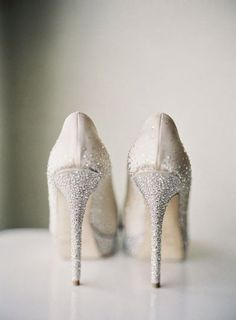 Snowy crystal-covered Jimmy Choos. My Chris will need to ask me to marry him all over again so I can rock these shoes! LOL