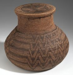 Africa | Basket with lid collected in Nalolo, Barotseland; possibly Lozi people | Wood, plant fiber and dye | ca. 1907