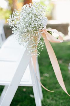 White Wooden Chairs for Ceremony AND reception. Ceremony will have babys breath on chairs and for the reception will be transfered to table center pieces
