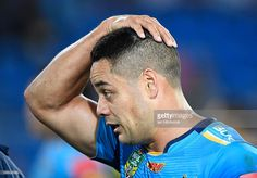 Jarryd Hayne of the Titans looks dejected after losing the round 25 NRL match…