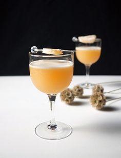 Fresh Ginger Amaretto Sour Cocktails - Ginger, Lemon Juice, Amaretto, Angostura Bitters, Egg White, Crystallized Ginger for Garnish.