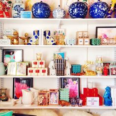 retail shelving, staffordshire dogs, blue and white ginger jars, bright and colorful retail, furbish studio