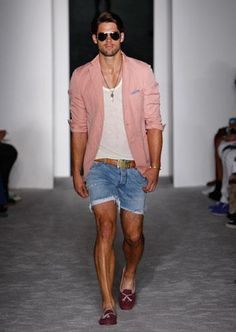 Denim shorts and tank top paired up with a linen sport jacket and cool shades makes for a great outdoor event. Courtesy of Michael Bastian. #mensfashion #menswear #menstyle #TRGent