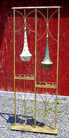 wow..Plant stand room dividing lamp with ceramic swag globes.  These were big in the 60s & 70s