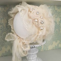 Lace Bonnet with removable Tieback, newborn size.Please allow up to 10 days for this item to ship as it is made to order.