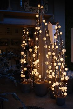 topiaries…simple…  would go well with the clear Christmas ornament 'chandelier'.