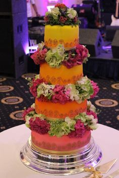 Parminder: Sunset Ombre Wedding Cake in yellow, orange and pink with Bespoke Piped Gold Motif and Fresh Flowers