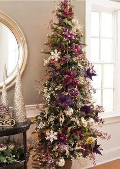 Liked on Pinterest: Purple white and gold tree! I'm intrigued with these colors. Perhaps for the church vestibule since purple is the color of royalty.
